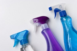 Plastic Spray Bottles on White Background, detergent for cleaning bathroom and kitchen.