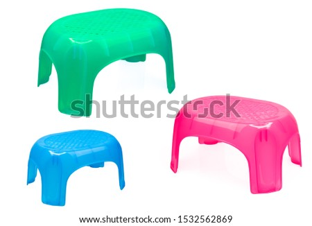 Plastic stool for bathroom or kitchen. Children chair. Green, blue, and pink plastic stool isolated on white background. Stepping stool for adult and kids. Portable and light weight step stool.