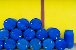 Plastic Storage Drum, Blue Barrel. Isolated on yellow background