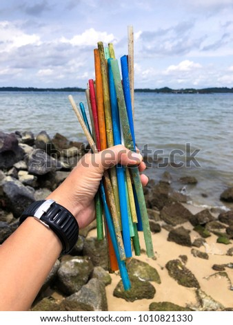 Plastic straws found on a beach in Singapore #1010821330