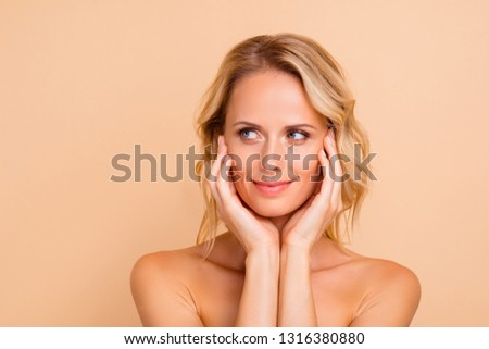 Plastic surgery perfection concept. Close-up portrait of attractive charming wavy-haired lady with perfect flawless smooth fresh skin touching cheeks detox looking aside isolated over beige background