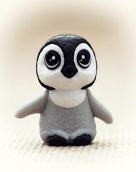 Plastic toy figurine - cute penguin cub.