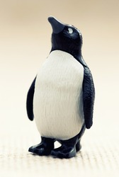 Plastic toy figurine - funny penguin standing.