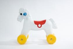 Plastic toy horse on white background