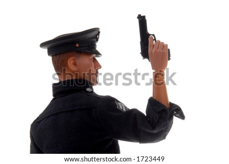 plastic toy police officer with gun in hand - stock photo