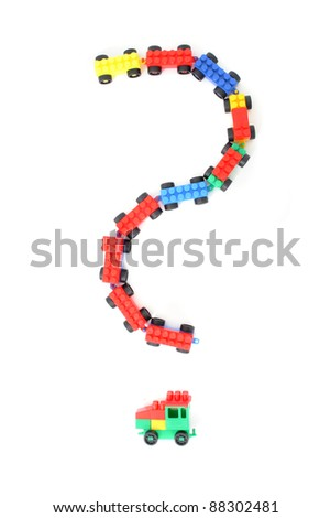 plastic toy train as question isolated on the white background
