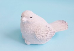 plastic toy white bird on a blue background