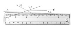 Plastic transparent ruler with graphite pencil degrees and lines scribble isolated on white background, top view