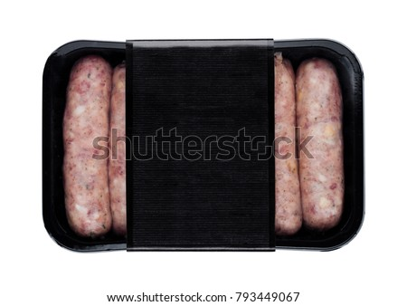 Plastic tray of raw pork beef sausages with black label isolated on white #793449067