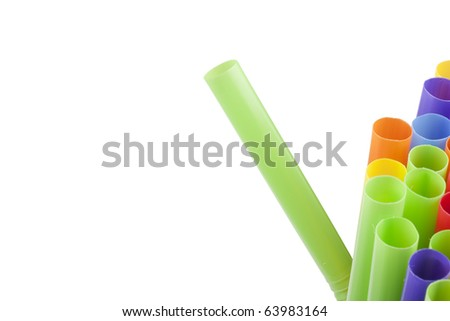 Plastic tubes of different colors in the background.