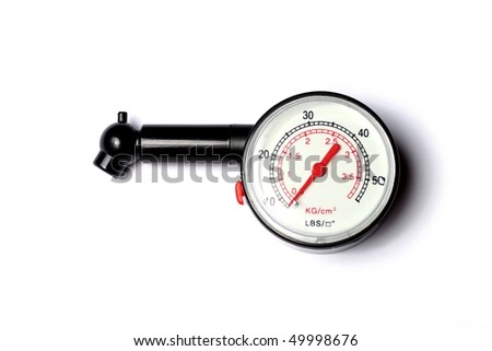 Plastic tyre-pressure gauge on white background
