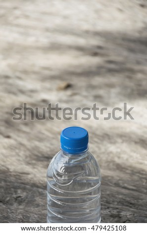 Plastic water bottle on wooden table texture. Fresh concept.
