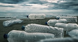 Plastic water bottles pollution in ocean (Environment concept)
