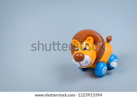 Plastic wind-up toy lion