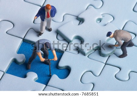 plastic workers fixing a puzzle