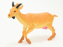 plastic yellow toy goat on a white background