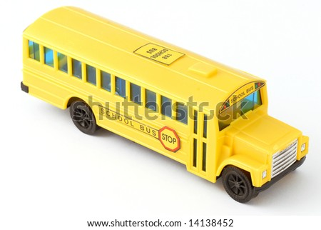 plastic yellow toy school bus on white background