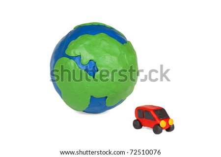 Plasticine globe and a car on a white background