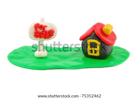 Plasticine house and For Sale real estate sign isolated on white background