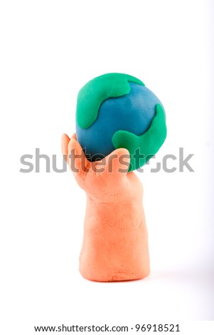 Plasticine of hand holding the Earth