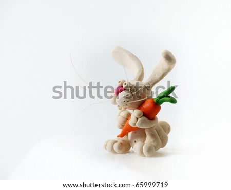 Plasticine rabbit on a white background.
