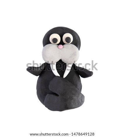 Plasticine walrus isolated on a white background. Walrus blinded by a child from plasticine, mammals.
