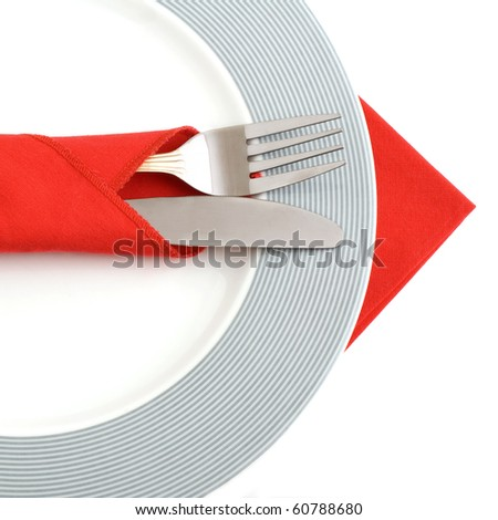 Plate and cutlery on white.