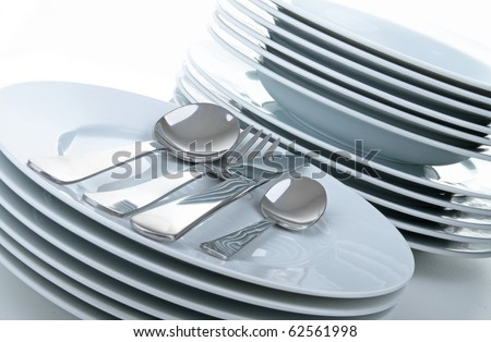 plate and cutlery on white