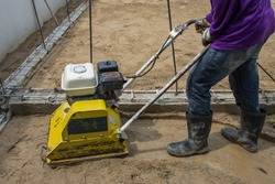 Plate compactor for compacting soil