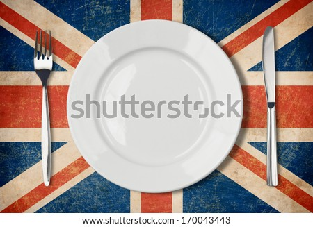 Plate, fork and knife on grunge UK flag Stock photo ©