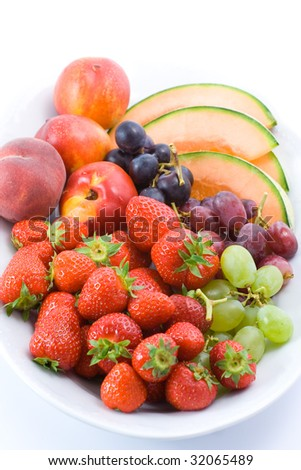 Plate full of different tasty fruit. Isolated on white.