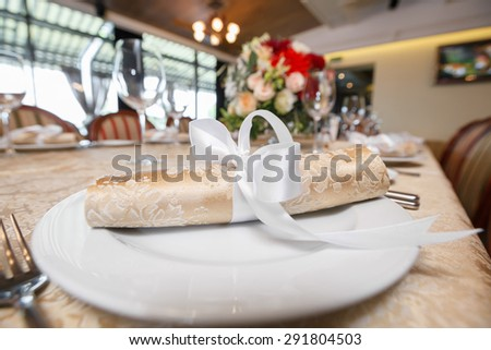 plate in restaurant.  napkin on the table