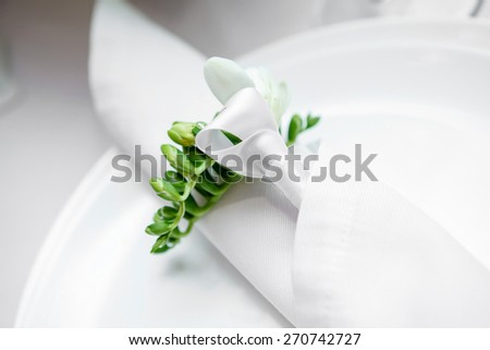 plate in restaurant. white napkin on the table