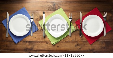 plate, knife and fork on table napkin cloth, top view