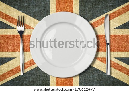 Plate, knife and fork over british flag canvas Stock photo ©