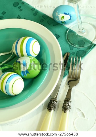 Plate, knife, fork and easter eggs