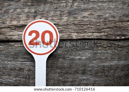 Plate number on a old wooden background. Numbers for lists or numbering concept.  #710126416