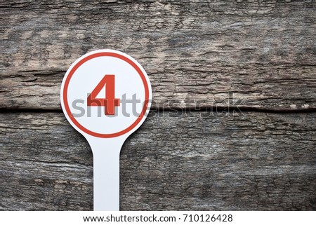 Plate number on a old wooden background. Numbers for lists or numbering concept.  #710126428