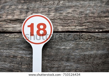 Plate number on a old wooden background. Numbers for lists or numbering concept.  #710126434