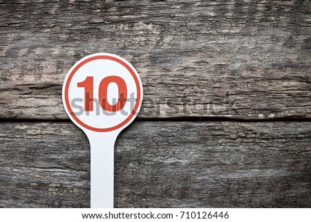 Plate number on a old wooden background. Numbers for lists or numbering concept.  #710126446