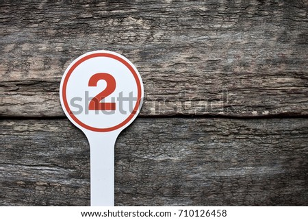 Plate number on a old wooden background. Numbers for lists or numbering concept.  #710126458