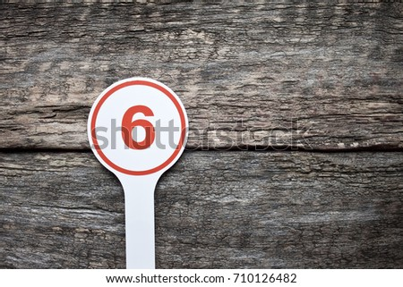 Plate number on a old wooden background. Numbers for lists or numbering concept.  #710126482