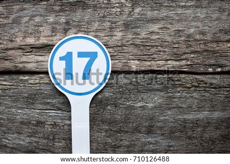Plate number on a old wooden background. Numbers for lists or numbering concept.  #710126488