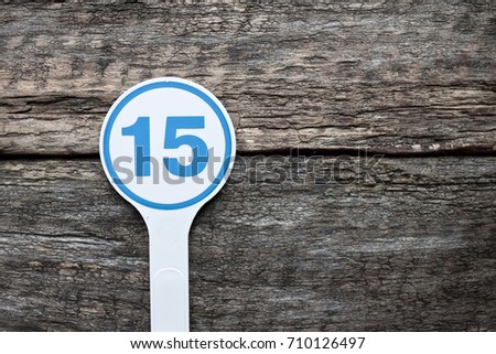 Plate number on a old wooden background. Numbers for lists or numbering concept.  #710126497