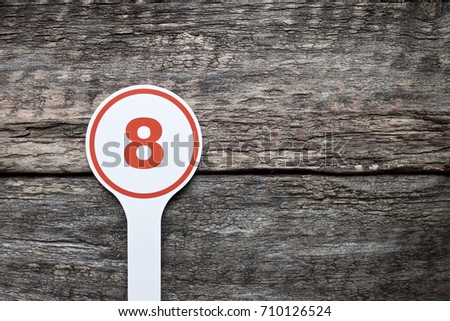 Plate number on a old wooden background. Numbers for lists or numbering concept.  #710126524