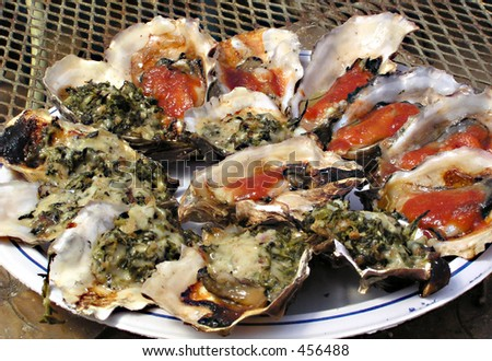 plate of Bar b qued oysters with bar b que sauce and Rockerfeller style with spinach and cheese