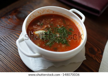 Plate of borsch in the russian restaurant