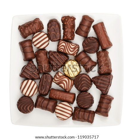 Plate of chocolates isolated on white background