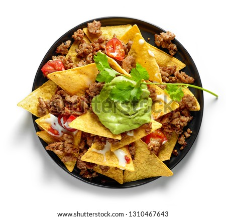plate of corn chips nachos with fried minced meat and guacamole isolated on white background, top view Foto stock ©