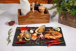 plate of crustacean seafood with mussels, hrimps, oysters as an ocean gourmet dinner